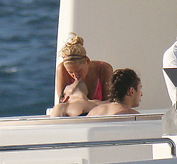 Jan 06, 2005; St Barthelemy, French West Indies; Star couple Singer ENRIQUE IGLESIAS and Tennis star ANNA KOURNIKOVA kiss while relaxing on hoilday. Anna wears a skimpy bikini in the sun on a yacht, Anna had time for a cigarette before watching Enrique taking a riding on a jet-ski. .  (Credit Image: Big Pictures/ZUMAPRESS.com)
