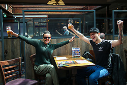 © Licensed to London News Pictures. 17/05/2021. London, UK. Pub goers with pint of beer gesture in The Toll Gate - JD Wetherspoon pub, north London, as step three of the government's roadmap to ease the Covid-19 restrictions goes live, allowing for indoor hospitality to reopen, with table service only as people are not able to order from the bar. Photo credit: Dinendra Haria/LNP