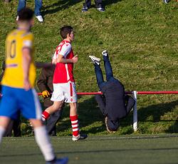 A fan falls over the pole. Broxburn Athletic FC 3 v 0 Cowdenbeath, William Hill Scottish Cup 2nd Round replay played 26/10/2019 at Albyn Park, Greendykes Road, Broxburn.