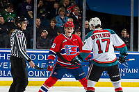 KELOWNA, CANADA - MARCH 13: Jack Finley #26 of the Spokane Chiefs smiles at Alex Swetlikoff #17 of the Kelowna Rockets prior to the face off on March 13, 2019 at Prospera Place in Kelowna, British Columbia, Canada.  (Photo by Marissa Baecker/Shoot the Breeze)