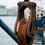 Rusted pulley, or block, on a commercial fishing boat, Gloucester, Massachusetts