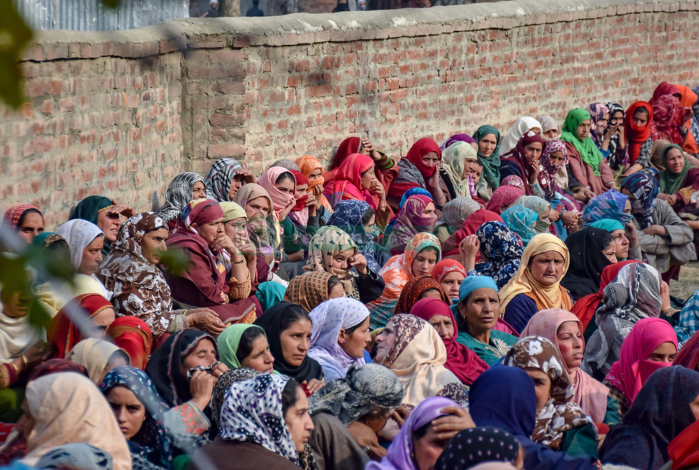 """November 10, 2018 - Pulwama, Jammu & Kashmir, India - Kashmiri Muslims are seen watching a funeral procession of the Slain Militant Liyakat Ahmed at his native village in Pulwama..Thousands of people have participated in the funeral prayers of the two militants who were killed in a gunfight with the government forces in south Kashmir's Pulwama district 40kms from summer capital Srinagar. The militants, according to Inspector General of Police, Kashmir Range, SP Pani, were killed in a """"very brief"""" shootout in Tikken village. (Credit Image: © Idrees Abbas/SOPA Images via ZUMA Wire)"""