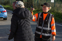 Harefield, UK. 12th September, 2020. A security guard working on behalf of HS2 takes a photograph of an environmental activist from HS2 Rebellion during the blockading of a gate providing access to a site for the HS2 high-speed rail link. Anti-HS2 activists continue to try to prevent or delay works on the controversial £106bn HS2 high-speed rail link in the Colne Valley where thousands of trees have already been felled.