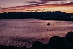 THEMENBILD - ein Angler mit seinem Boot in der Adria bei Sonnenuntergang, aufgenommen am 14. August 2019 in Rijeka, Kroatien // an fisherman in his boat in the Adriatic Sea at sunset in Rijeka, Croatia on 2019/08/14. EXPA Pictures © 2019, PhotoCredit: EXPA/ JFK