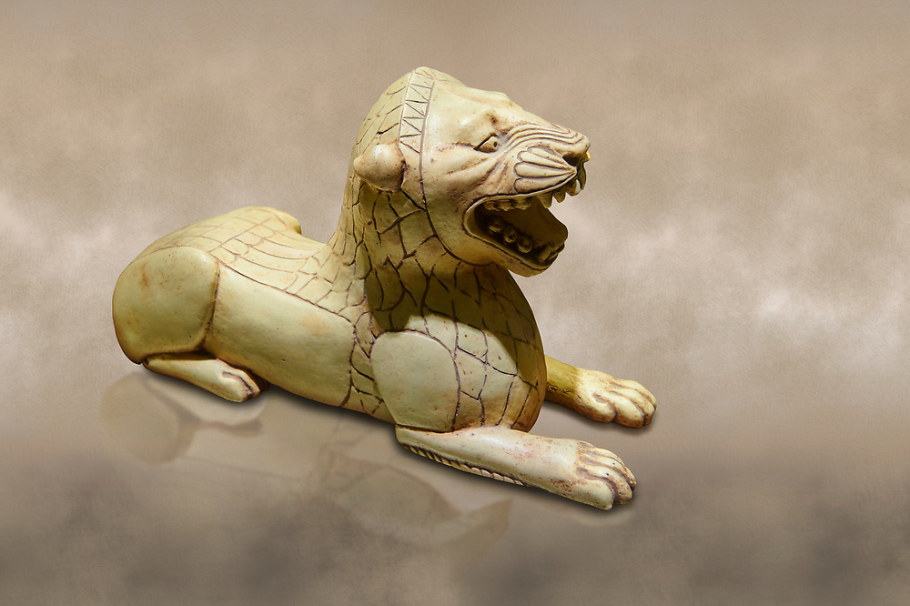Phrygian ivory statuette carved as a roaring lion lying down from a table base decoration. From Gordion. Phrygian Collection, 8th-7th century BC - Museum of Anatolian Civilisations Ankara. Turkey. Against an art background .<br /> <br /> If you prefer you can also buy from our ALAMY PHOTO LIBRARY  Collection visit : https://www.alamy.com/portfolio/paul-williams-funkystock/phrygian-antiquities.html  - Type into the LOWER SEARCH WITHIN GALLERY box to refine search by adding background colour, place, museum etc<br /> <br /> Visit our CLASSICAL WORLD PHOTO COLLECTIONS for more photos to download or buy as wall art prints https://funkystock.photoshelter.com/gallery-collection/Classical-Era-Historic-Sites-Archaeological-Sites-Pictures-Images/C0000g4bSGiDL9rw