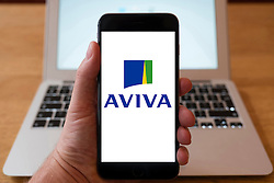 Using iPhone smartphone to display logo of Aviva insurance company