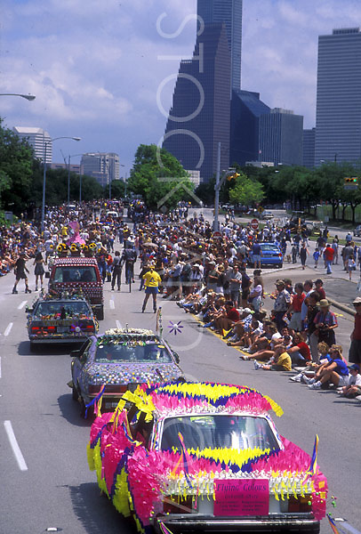 Stock photo of a line of art cars in the parade