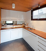 white kitchen interior with wooden ceiling