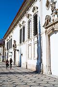 Young women walking by Aveiro Museum - Museo de Aveiro, 15th Century Santa Joana Antigo Convento de Jesus, Portugal