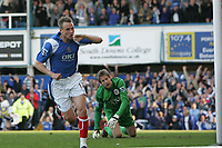 Photo: Lee Earle.<br /> Portsmouth v Manchester United. The Barclays Premiership. 07/04/2007.Poertsmouth's Matthew Taylor (L) celebrates scoring their first goal. United keeper Edwin Van Der Sar (R) looks dejected.