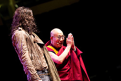 © Licensed to London News Pictures. 16/06/2012. Manchester , UK . Russell Brand introduces The Dalai Lama at the Manchester Arena , Greater Manchester , at the Stand Up and Be the Change youth event . The Dalai Lama is on a 10 day tour of the UK . Photo credit : Joel Goodman/LNP