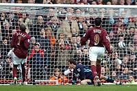 Photo: Ed Godden.<br />Arsenal v Aston Villa. The Barclays Premiership. 01/04/2006. Abou Diaby (L) scores Arsenals 5th goal.