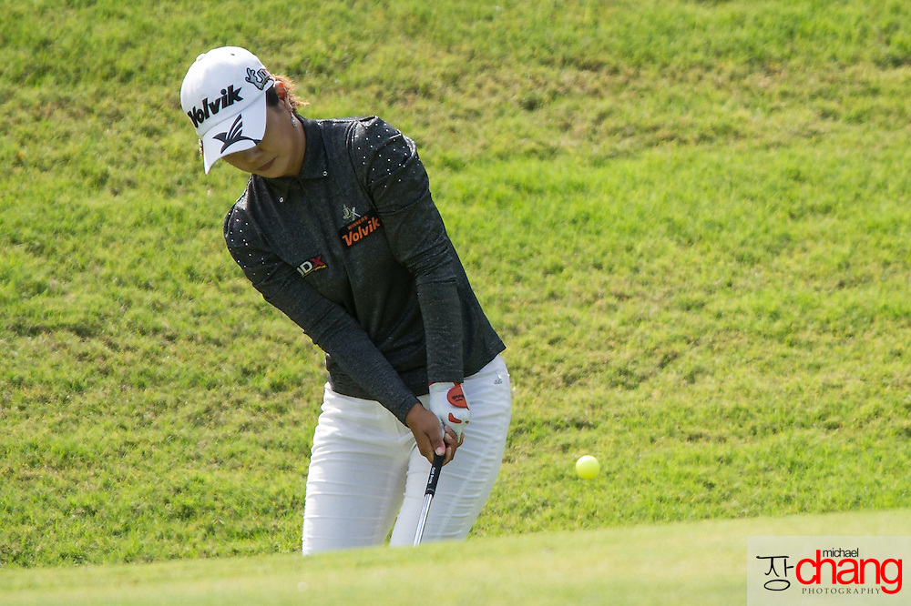 April 28 2012: South Korea's Meena Lee chips the ball on to the green on the 17th hole during the third round of the Mobile Bay LPGA Classic at Magnolia Grove in Mobile, AL.