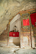 Built in rock Church of Panagia Theoskepasti interior with icons and decorations, Ikaria, Greece