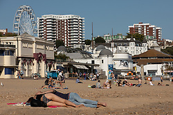 © Licensed to London News Pictures . 13/09/2019. Bournemouth, UK. People sunbathe on the beach in Bournemouth as a late summer heatwave brings high temperatures to the south coast of England . Photo credit: Joel Goodman/LNP