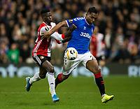 Football - 2019 / 2020 UEFA Europa League - Group G: Rangers vs. Feyenoord<br /> <br /> Alfredo Morelos of Rangers vies with Edgar Ie of Feyenoord, at Ibrox.<br /> <br /> COLORSPORT/BRUCE WHITE