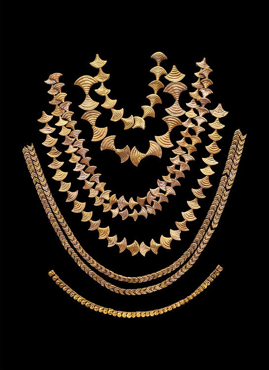 Mycenaean gold necklaces from the Mycenae chamber tombs, Greece. National Archaeological Museum Athens. Black Background<br /> <br /> From top to bottom: <br /> <br /> Top four  necklaces in the shape of papyrus flowers .<br /> <br /> Fifth necklace down in the shape of Ivy leaves from tomb 91 Cat No 3186<br /> <br /> <br /> Bottom necklace with beads in the shape of hangimng scrolls from tomb 25 Cat No 2478. .<br /> <br /> If you prefer to buy from our ALAMY PHOTO LIBRARY  Collection visit : https://www.alamy.com/portfolio/paul-williams-funkystock/mycenaean-art-artefacts.html . Type -   Athens    - into the LOWER SEARCH WITHIN GALLERY box. Refine search by adding background colour, place, museum etc<br /> <br /> Visit our MYCENAEN ART PHOTO COLLECTIONS for more photos to download  as wall art prints https://funkystock.photoshelter.com/gallery-collection/Pictures-Images-of-Ancient-Mycenaean-Art-Artefacts-Archaeology-Sites/C0000xRC5WLQcbhQ
