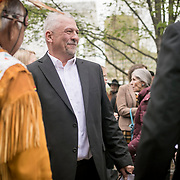 Monacan Chief, Dean Branham, center, greets former Virginia Governor, George Allen, right and Ben Adams, of the Upper Mattaponi Tribe, prior to the dedication ceremony for Mantle: Virginia Indian Tribute, a monument designed on Virginia State Capitol Square, in Richmond, Virginia, on Tuesday, April 17, 2018. As a U.S. Senator, George Allen first introduced the Thomasina E. Jordan bill along with Sen. John Warner, federally recognizing Monacan Indian Nation along with 5 other Virginia Tribes. This past January, the bill was signed into law. John Boal Photography