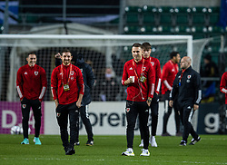TALLINN, ESTONIA - Monday, October 11, 2021: Wales' captain Aaron Ramsey (R) and Joe Allen (L) on the pitch before the FIFA World Cup Qatar 2022 Qualifying Group E match between Estonia and Wales at the A. Le Coq Arena. Wales won 1-0. (Pic by David Rawcliffe/Propaganda)