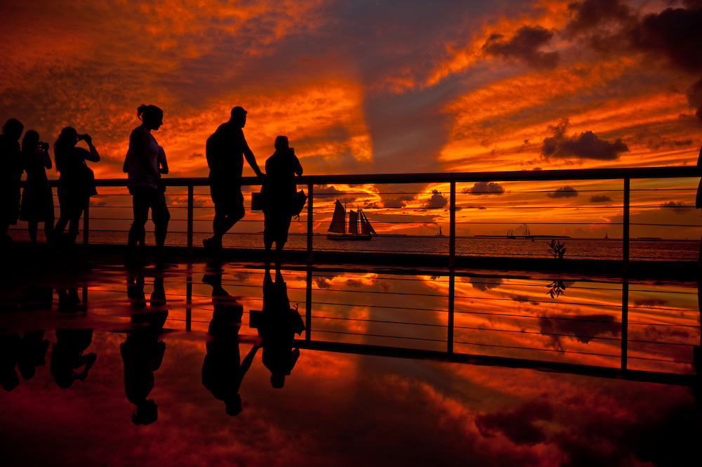 People gather to watch the sunset from Mallory Square in Key West, Florida.