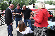 Liverpool legend Steve McMahon shows the fans his league winners medal from 30 years ago as fans celebrate outside the stadium and through the city before and during the Premier League match between Liverpool and Aston Villa at Anfield, Liverpool, England on 5 July 2020.