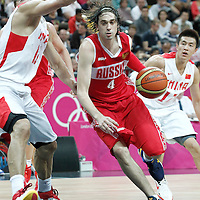 31 July 2012: Russia Alexey Shved drives past China Jianlin Yi during the 73-54 Russia victory over China, during the men's basketball preliminary, at the Basketball Arena, in London, Great Britain.