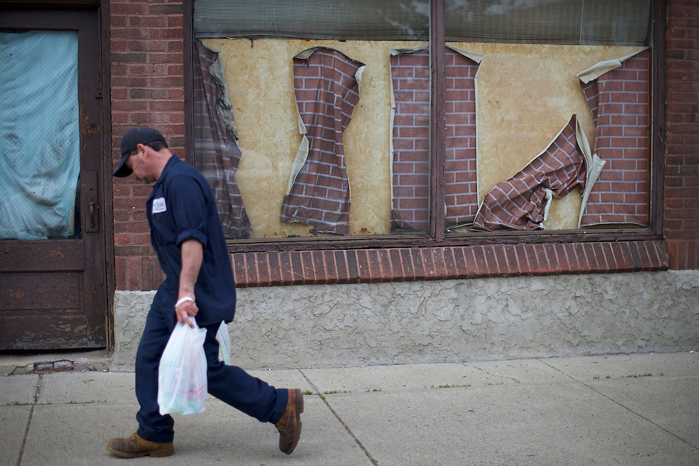 WILKES-BARRE- May 26, 2016.  A man walks past a shuttered store in Wilkes-Barre, PA, a city of 41,000 in central Pennsylvania.  Wilkes-Barre is the county seat of Luzerne County, in which 77.4% of Republicans voted for Donald Trump.