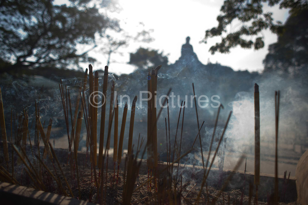 Incense sticks burn below the Giant Buddha at Po Lin Monastery near Ngong Ping village.