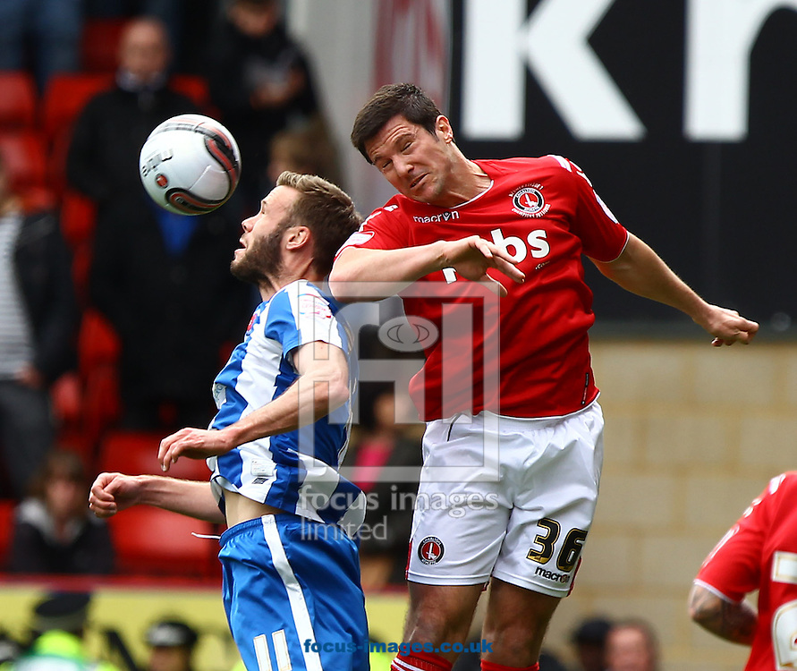 Picture by John Rainford/Focus Images Ltd. 07506 538356.05/05/12.Yann Kermorgant of Charlton Athletic and Andy Monkhouse of Hartlepool United during the Npower League 1 match at The Valley stadium, London.
