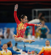BEIJING, CHINA:  China's gymnast Yuyuan Jiang performs her  floor exercise during the women's Gymnastics Team Finals at the 2008 Olympics in Beijing, China  on Wednesday,8/13/08 in Beijing, China. The United States finished second and China finished first in the event.  ©2008 Johnny Crawford