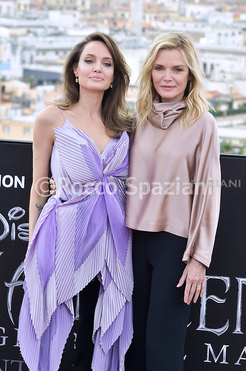 """ROME, ITALY - OCTOBER 07: Angelina Jolie and Michelle Pfeiffer attends the photocall of the movie """"Maleficent – Mistress Of Evil"""" at Hotel De La Ville on October 07, 2019 in Rome, Italy."""