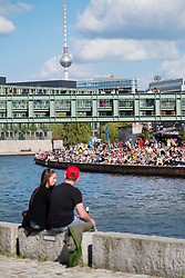 Outdoor riverside bar beside Spree River in summer in Berlin, Germany
