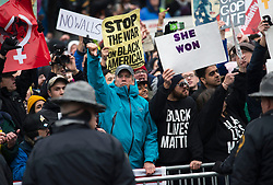 Protesters demonstrate as President Donald Trump and First Lady Melania Trump walk in their inaugural parade after being sworn-in as the 45th President in Washington, D.C. on January 20, 2017. Photo by Kevin Dietsch/UPI