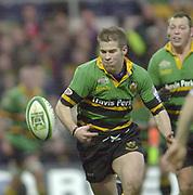 Photo Peter Spurrier<br /> 07/12/2002<br /> European Rugby - Heineken Cup Northamton vs Cardiff.<br /> Saints Chris Hyndman run's onto the  ball.