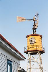 Water tower with windmill  at Cotton Belt Railroad Depot, Grapevine, Texas USA