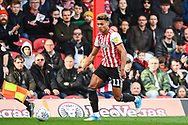 Brentford Forward Oliver Watkins (11) in action during the EFL Sky Bet Championship match between Brentford and Queens Park Rangers at Griffin Park, London, England on 2 March 2019.