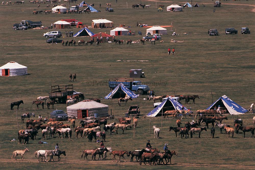 Naadam village<br /> Naadam horse race<br /> Jockey's aged 4-12 years and most often girls<br /> Ulaanbaatar race track<br /> Mongolia