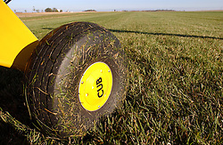 Piper Cub on a grass strip, Indiana...Photo by Matt Cashore..Use of this image prohibited without authorization and/or compensation..To contact Matt Cashore:.574.220.7288.cashore1@michiana.org.www.mattcashore.com