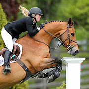 NORTH SALEM, NEW YORK - May 15: Sarah Scheiring, USA, riding Dontez, in action during The $50,000 Old Salem Farm Grand Prix presented by The Kincade Group at the Old Salem Farm Spring Horse Show on May 15, 2016 in North Salem. (Photo by Tim Clayton/Corbis via Getty Images)