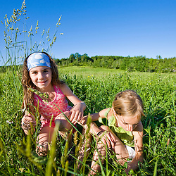 Young girls play in a field in Sabins Pasutre in Montpelier, Vermont.