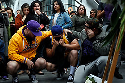 File photo of Fans Alex Fultz, Eddy Rivas and Rene Alfaro, left to right, stand near a memorial for Kobe Bryant, who died in a helicopter crash, on Sunday, Jan. 26, 2020 at Staples Center in Los Angeles, Calif. (Dania Maxwell/Los Angeles Times/TNS/ABACAPRESS.COM)