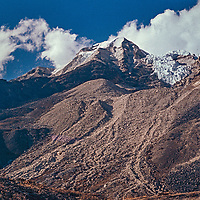 IIsland Peak rises above the Imja Valley, just south of Lhotse in the n the Khumbu region of Nepal;s Himalaya.