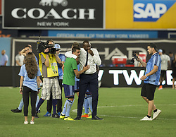 August 20, 2017 - New York, New York, United States - David Villa (7) & coach Patrick Vieira of NYC FC celebrate victory after regular MLS game against New England Revolution on Yankee stadium NYC FC won 2 - 1  (Credit Image: © Lev Radin/Pacific Press via ZUMA Wire)