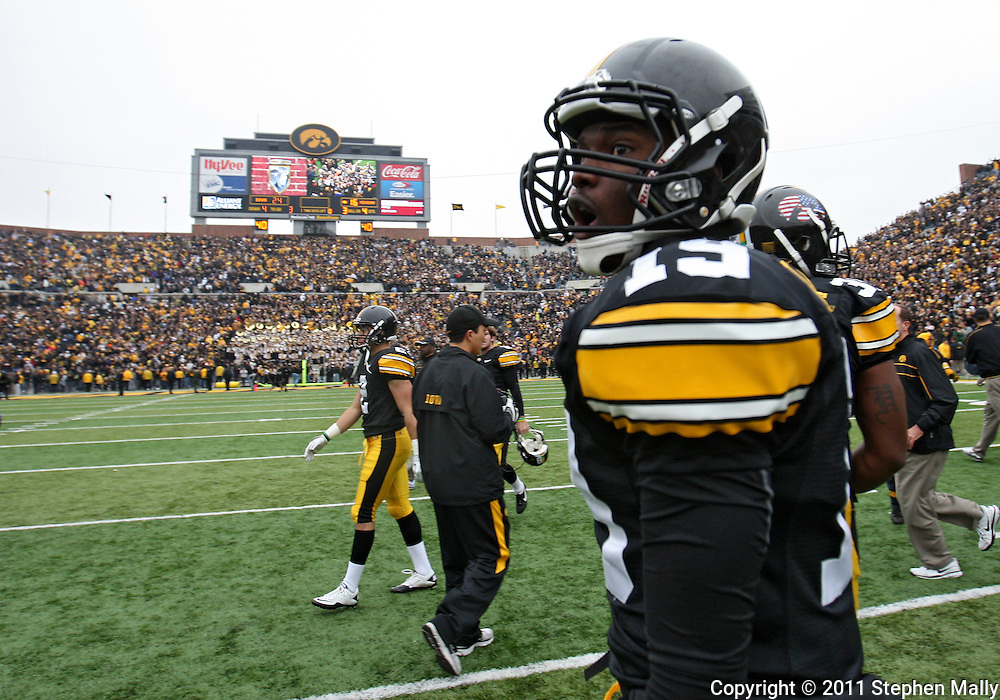 November 05, 2011: Iowa Hawkeyes defensive back B.J. Lowery (19) celebrates after breaking up a pass in the end zone on the final play of the game at the end of the NCAA football game between the Michigan Wolverines and the Iowa Hawkeyes at Kinnick Stadium in Iowa City, Iowa on Saturday, November 5, 2011. Iowa defeated Michigan 24-16.