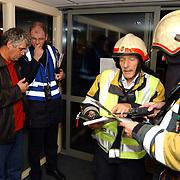 Brandweeroefening bejaardentehuis de Bolder Huizen, overleg, BHV, commandant, bevelvoerder