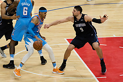 March 10, 2018 - Los Angeles, CA, U.S. - LOS ANGELES, CA - MARCH 10: LA Clippers forward Tobias Harris (34) drives to the basket against Orlando Magic center Nikola Vucevic (9) during the game between the Orlando Magic and the LA Clippers on March 10, 2018, at STAPLES Center in Los Angeles, CA. (Photo by David Dennis/Icon Sportswire) (Credit Image: © David Dennis/Icon SMI via ZUMA Press)