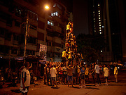 Residents of Santa Cruz practice their human tower for Dahi Handi in this neighborhood of Mumbai, India on August 23, 2019. Dahi Handi celebrates the birth of the Hindu god Krishna.