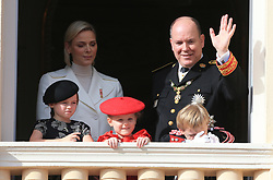 Princess Charlene, Princess Gabriella, Prince Jacques and Prince Albert II The royal family of Monaco posing at the balcony of the Grimaldi castle for the National Day festivities on November 19th 2019.