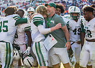 Dutch Fork Silver Foxes head coach Tom Knotts hugs Dutch Fork Silver Foxes quarterback Tyler Olenchuk (10) after beating Dorman Cavaliers in the Class AAAAA State Championship Game at Williams-Brice Stadium in Columbia, SC. Dutch Fork Silver Foxes won 34-31. Dutch Fork wins their 4th straight state championship at Williams Brice Stadium. Photos ©JeffBlakePhoto.com