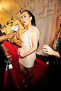 "After dinner with Reggie Kim Kardashian changed clothes and arrives again to a thron of paparazzi and other media at her Leather and Lace Super Bowl party, and give me a look..like she know me!!!! Paparazzi get to close to comfort while trying to catch a photo of Saints running back Reggie Bush and girlfriend Kim Kardashian. After being a perfect gentleman an escorting everyone into the truck Kim finally tells everyone to ""Back UP"" .... Reggie is Playing on Sunday..New Orleans Saints RB #25 Reggie Bush escorts his girlfriend Kim Kardashian into their chauffered Cadilac Escalade , as the Paparazzi get to close  for comfort and upset him, after having his last meal out with his parents younger brother Jovan and kims mother and brother at Prime 112 on Ocean Drive in Miami before the Big Super Bowl on Sunday, tonight the team had a curfew so he could not attend Kim Super Bowl Bash Leather & Lace Super Bowl Party Friday night Feb 5,2010. Photo©Suzi Altman/SuziSnaps"